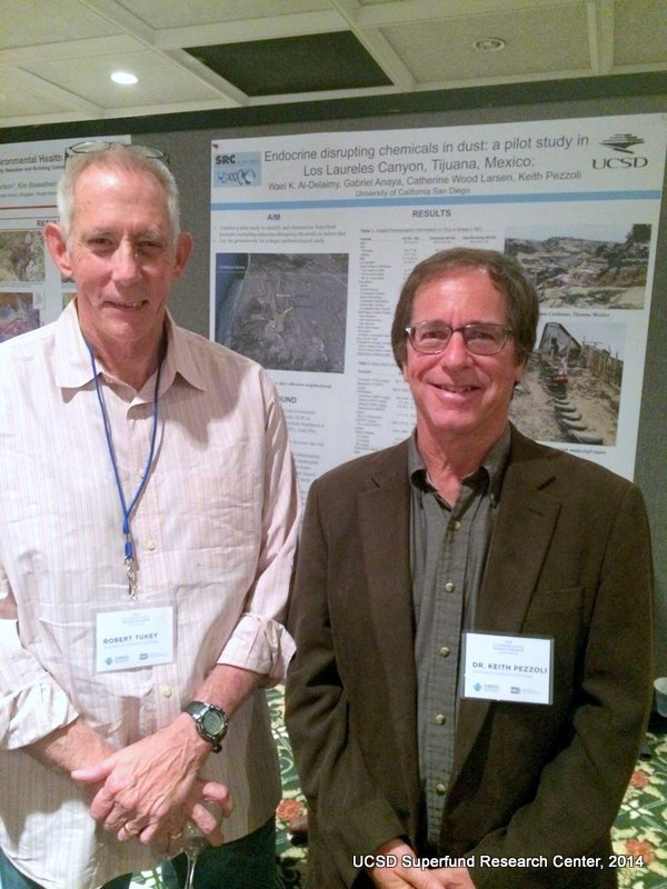 Drs. Robert Tukey and Keith Pezzoli discuss CEC poster